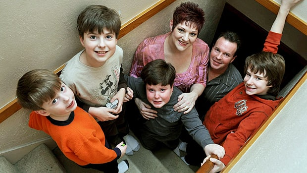 Kelli and Keith Gibson of Battle Creek, Mich., pose for a 2010 photo with their sons, from left, Kolten, 6, Keifer, 9, Caiden, 7 and Connor, 11, who all have different forms of autism. Kelli Gibson said it doesn't make sense to give them different labels, including Asperger's.
