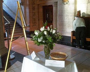 Flowers in House of Commons foyer commemorate the 23rd anniversary of 14 murdered women at l' Ecole Polytechnique in Montreal.