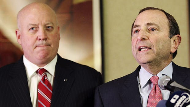 NHL Commissioner Gary Bettman, right, and deputy commissioner Bill Daly speak to reporters, Thursday, Dec. 6, 2012, in New York. The NHL rejected the players' latest offer for a labour deal.