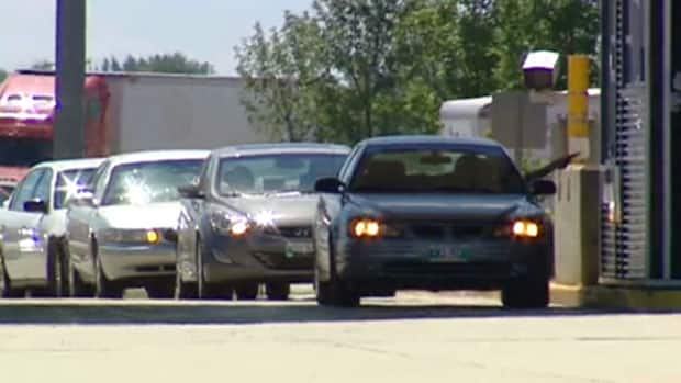 Drivers crossing the Canadian-U.S. border at Emerson, Man., are being warned of delays on Thursday, as some agents are refusing to work over a new name-tag policy.
