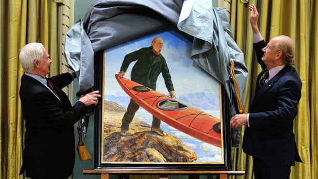 Governor General David Johnston and John Raulston Saul, the husband of former Governor General Adrienne Clarkson, unveil the portrait by artist Kent Monkman at Rideau Hall Monday.