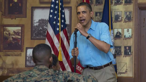 U.S. President Barack Obama speaks to members of the military and their families in Anderson Hall at Marine Corp Base Hawaii, on Christmas Day in Kaneohe Bay, Hawaii.