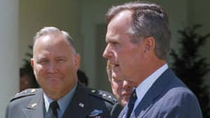 Gen. Norman Schwarzkopf, left, looks on as President George Bush speaks to reporters in the White House Rose Garden in Washington in April 1991.