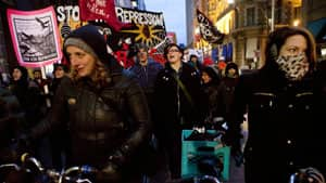 Occupy Toronto protesters march along Toronto's King Street last November.