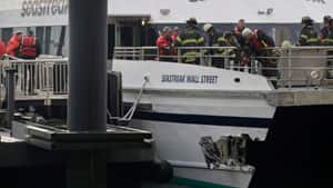 New York City firefighters walk the deck of the Seastreak Wall Street ferry in New York City after it banged into a pier in lower Manhattan during morning rush hour.
