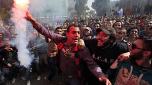 Some Egyptians, like these men in Cairo, celebrated the verdict that returned 21 death penalties, while others said they were evidence of scapegoating.