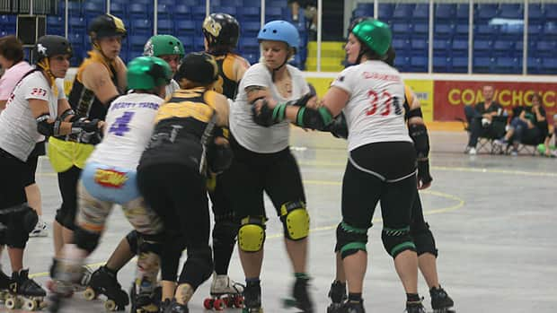 The Hammer City Roller Girls host a bout at a Dundas rink in August 2012.