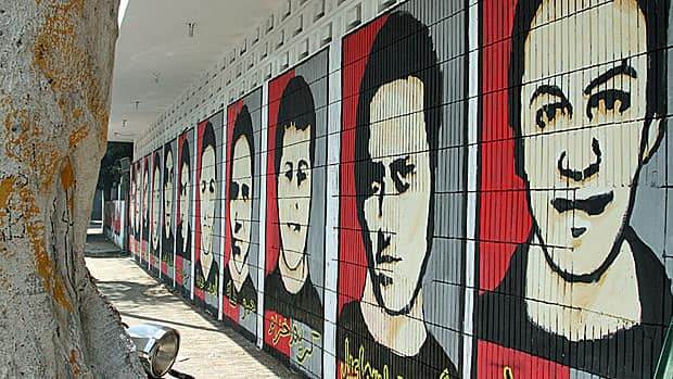 Images of Al-Ahly soccer fans killed in a post-game riot a year ago adorn the wall leading to the club's main entrance in Cairo.