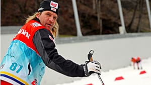 An Austrian nordic skier checks out the practice run on Jan. 31 in the rain.
