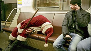 A drunk man dressed as Santa Claus sleeps on an underground train in Moscow on Jan. 1, 2006.