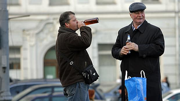 Drinking in public, in this instance on a Moscow street, is common in Russia.