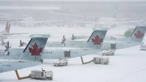 Air Canada has been forced to cancel scores of flights because of the storm.