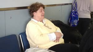 Penny Fennell from Georgia waits patiently at Pearson International Airport after her flight was cancelled because of Friday's storm.