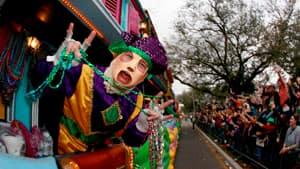 Members of the Krewe of Endymion parade down Orleans Avenue in New Orleans on Saturday ahead of Mardi Gras.