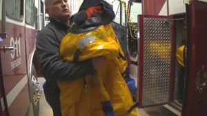 Murray River Fire Chief Troy Ferguson holding one of four new ice rescue suits.