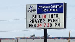 A sign outside Steinbach Christian High School announces the prayer event for Sunday.