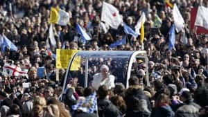 Pope Benedict XVI waves to the faithful as he arrived in St Peter's Square.