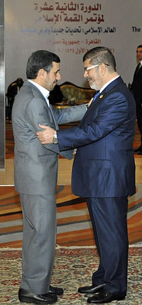 Egypt's Mohammed Morsi greets Iran's Mahmoud Ahmadinejad in Cairo last month. 'Hello. Is it me you're looking for?'