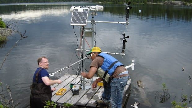 Scientists set up a raft with one of a series of micro-meteorological stations on one of 58 lakes in the Experimental Lakes Area. Scientific projects could die on the vine because of cuts to the federal Fisheries Department, university researchers say.