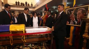 Venezuela's acting President Nicolas Maduro, Ecuador's President Rafael Correa, and his wife Anne Malherbe mourn next to the coffin containing the remains of  Venezuela's late President Hugo Chavez in Caracas, Venezuela, March 7.