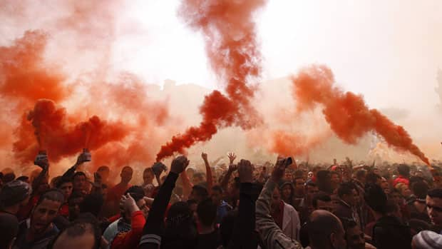 Al-Ahly fans, also known as Ultras, shout slogans Saturday against the Interior Ministry in front of the Al-Ahly club after hearing the final verdict of the 2012 Port Said massacre in Cairo, Egypt.