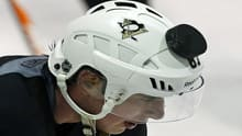 Pittsburgh Penguins captain Sidney Crosby lets a puck slide off his helmet in January. The new concussion guidelines apply to athletes of all skill levels age 13 and older.