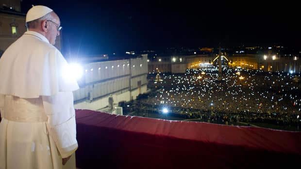 Pope Francis greets the crowd in St. Peter's Square after being elected to lead the Catholic church.