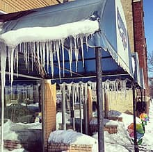 Icicles hang from the awnings in front of Ormistons Florist on Corydon Avenue as spring struggles to make its presence felt.