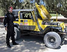 Dellen Millard stands beside the yellow Jeep he and Andrew Michalski drove in the 2011 Baja 500 off-road race.