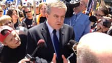 Premier David Alward was confronted by several angry health care workers at the union-organized rally.