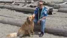 Walking a dog confers health benefits in terms of fitness and stress relief. Stuart and his dog Sandy go fishing in Vancouver.