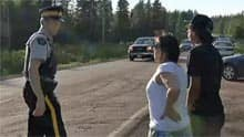 RCMP officer talks to shale gas protesters in Kent County earlier this month.