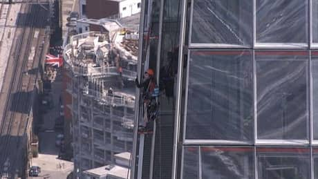 Greenpeace activists scale London's Shard building