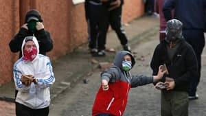 Loyalist rioters prepare to attack riot police in the Woodvale area of North Belfast on Saturday.
