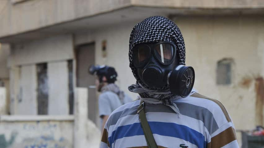 Syrian wears gas mask. (Reuters)