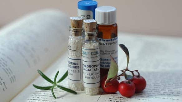 A collection of homeopathic treatments including preparations made with robinia, castor bean, silver phosphate, and clippings of wintergreen and rosemary.