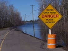 Increasingly, roads near Fredericton are being closed as waters continue to rise.