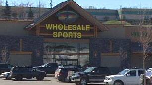 Police arrested a woman who had been working at Calgary's Wholesale Sports for about seven months.