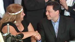 Aboriginal Affairs Minister Brad Duguid shakes hands with a First Nations woman.