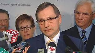 Alberta Premier Ed Stelmach, flanked by Justice Minister Alison Redford, left, and Solicitor General Fred Lindsay, right, speaks to reporters on Friday.