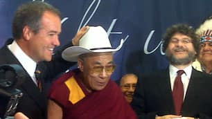 University of Calgary president Harvey Weingarten laughs as Mayor Dave Bronconnier gives the Dalai Lama one of the city