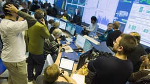 Scientists gather at the CERN data quality satellite control centre of the ATLAS detectors during the restart of the Large Hadron Collider in Meyrin, Switzerland, on Monday.