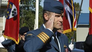 Col. Russ Williams, shown here at the Battle of Britain parade in Trenton, Ont., on Sept. 20, has been charged with first-degree murder in the deaths of two eastern Ontario women.