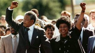 In this Sunday, Feb. 11, 1990 photo, Nelson Mandela and wife Winnie, walk hand-in hand-with their raised clenched fists upon Mandela's release from Victor Verster prison.