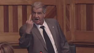 Liberal MLA Abel LeBlanc gives the finger to a Tory MLA during a heated exchange in the N.B. legislature.