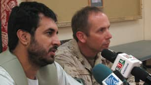 Asadullah Khalid, left, former governor of Kandahar province, and Brig.-Gen. Denis Thompson, then Canada's top soldier in Afghanistan, speak to reporters at a news conference in July 2008.
