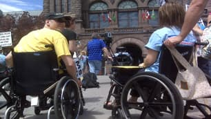 About 150 people gather at Queen's Park in Toronto to demand that  multiple sclerosis patients get access to a controversial new surgical  treatment.