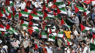 Demonstrators hold Palestinian flags during a protest against Israel at Taksim Square in Istanbul Monday
