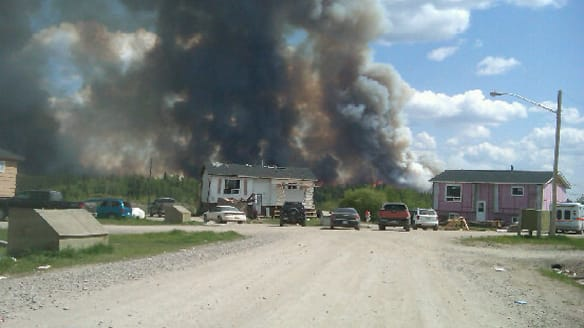 A forest fire burns close to the Northern Manitoba community of Nelson House.