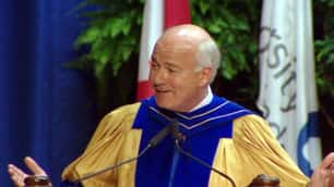 Mansbridge, who didn't graduate from high school, joked that while students had to spend at least four years at the university to get their degrees, all he had to do was show up Thursday.